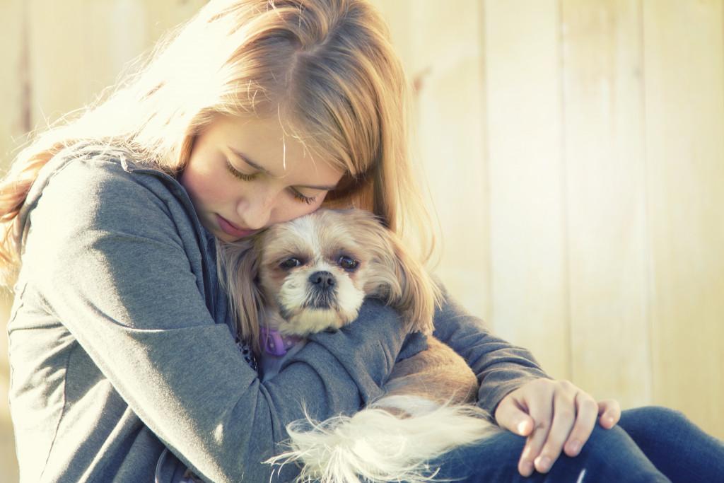 sad teenager with dog